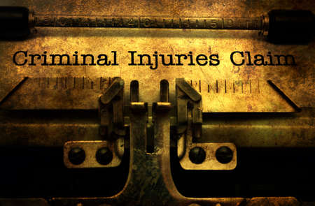 compensated: Criminal injuries claim grunge concept Stock Photo