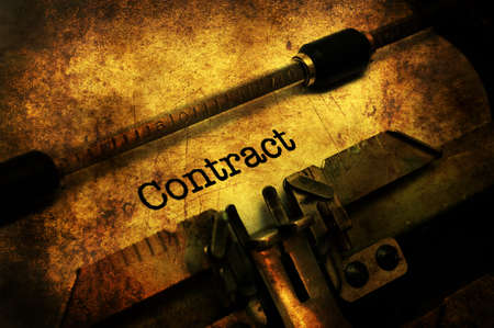 Contract on typewriter grunge concept Stock Photo
