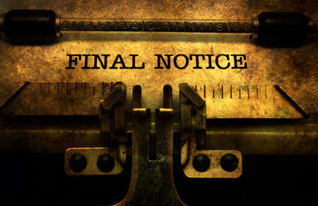 Final notice in typewriter Stock Photo