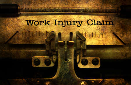 Work injury claim on typewriter Stock Photo