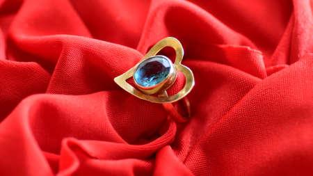 Diamond Ring On Red Satin