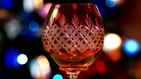 Red Wine Glass With Bokeh Lights In The Background