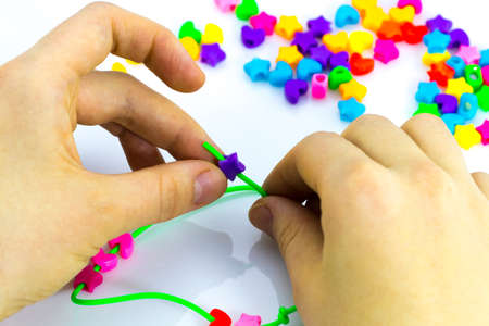 Making of handmade jewellery.multi colored beads isolated