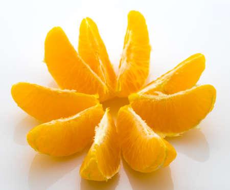 Slices of juicy tangerine isolated on white background Stock Photo