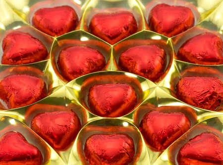 a box of chocolates in the shape of hearts close-up