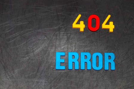 error message: 404 error message colored letters on black Board