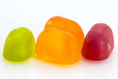 colorful fruit jelly candies isolated on white