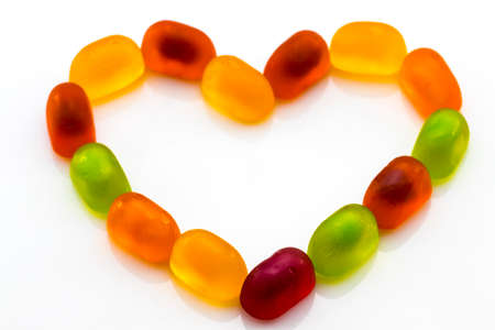 colorful fruit jelly candies isolated on white. Love
