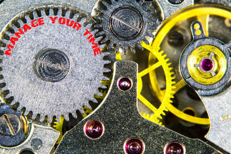The clockwork old mechanical  high resolution with words manage your times