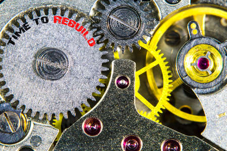 The clockwork old mechanical  high resolution with words Time to Rebuild