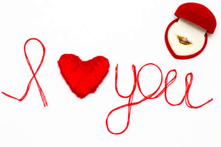valentines day mother s: Love you words and heart symbol made of red thread on a white background for your Valentines day
