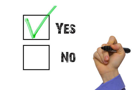 tickbox: Yes No tickbox with green red tick. Hand holding marker isolated on white boards Stock Photo