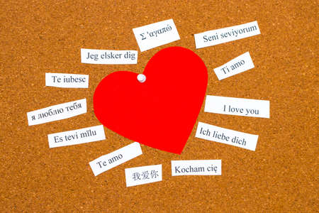 I Love You. Words printed on papers in different languages  Stok Fotoğraf