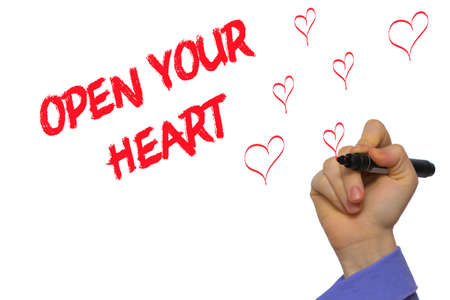 Man Hand writing Open your heart with marker on transparent wipe board. Isolated on white.