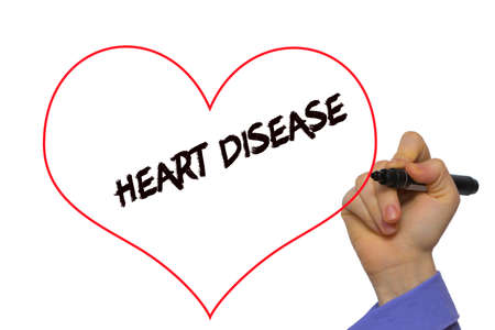 Man Hand writing Heart Disease with marker on transparent wipe board. Isolated on white Stock Photo