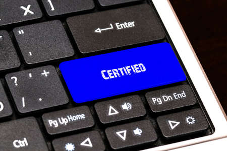 contracting: Business Concept - Blue Certified Button on Slim. Stock Photo