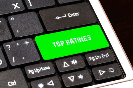 ratings: On the laptop keyboard the green button written TOP RATINGS.