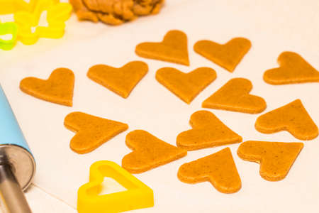 Making homemade christmas cookies in various shapes.