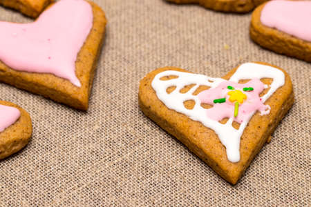 baby cookie on burlap in a heart shape.