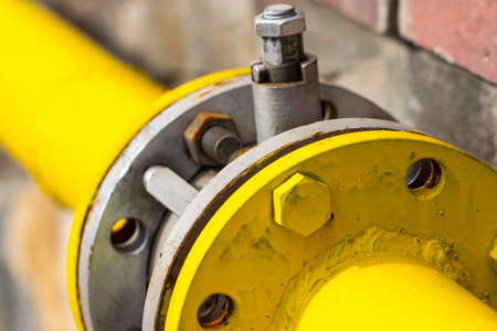 yellow gas pipe with a crane and gear. Stock Photo