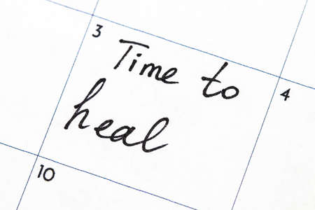 time to heal text write on calendar.