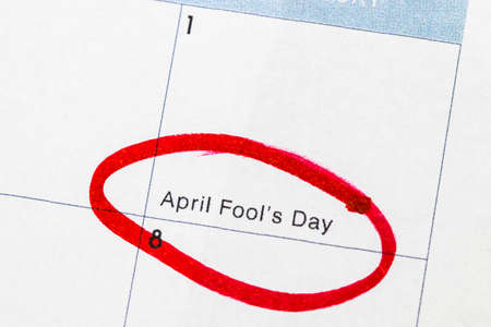 Fools day is a text written on the calendar, circled in red marker. Stock Photo