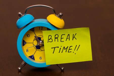 Break time concept with classic alarm clock.