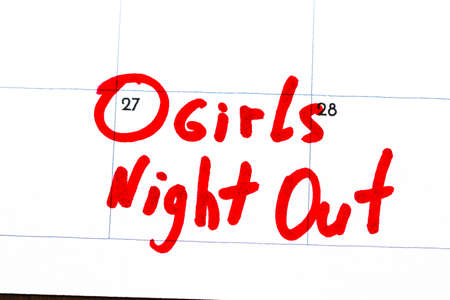 girls night out  is the text written on the calendar in red marker. Stock Photo