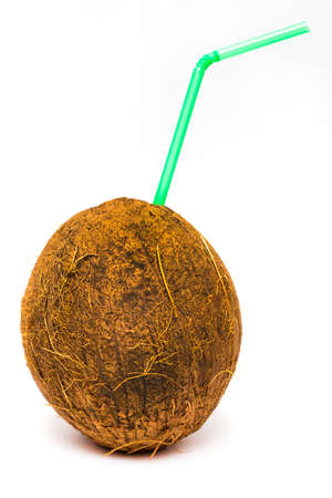 Coconut cocktail with a green straw isolated on white.