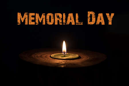 brightness: Memorial day, inscription on black background and candle.