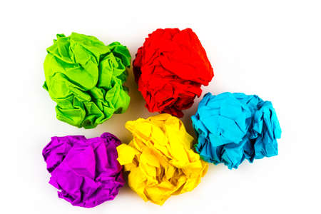 five colorful crumpled paper balls isolated on white.