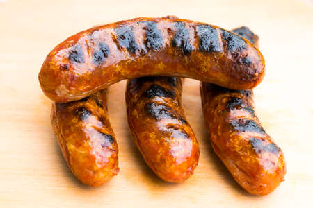 fryingpan: The Grilled sausage on a wooden board