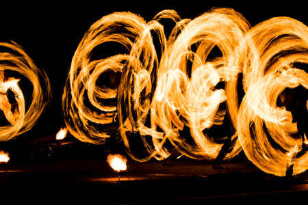 fire show and a lot of the bright sparks in the night. Stock Photo