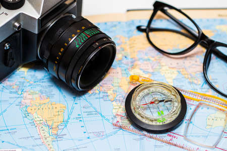 Adventure concept. Traveler items on map background. Stock Photo