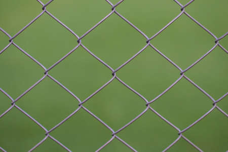 Views from the viewer through a steel mesh. Stock Photo