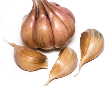Fresh garlic isolated on white background close-up.