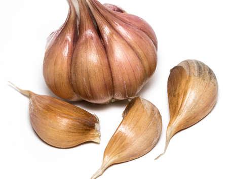 spiciness: Fresh garlic isolated on white background close-up.