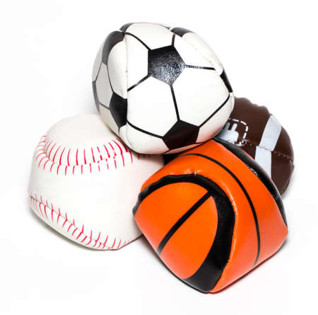 Collection of sport ball with soccer, rugby, baseball and basket ball on a white background. Stock Photo