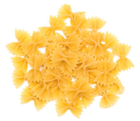 heap of  bow tie pasta isolated on white background.