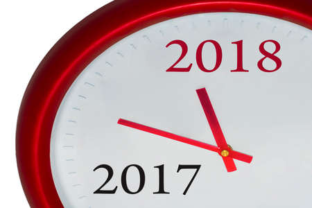 Red clock with 2017-2018 change represents coming new year 2018. Archivio Fotografico