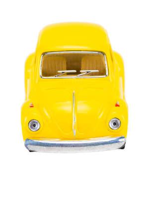 Yellow retro car isolated on white background. Stock Photo