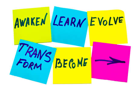 awaken, learn, evolve, transform and become - inspirational new year goals or resolutions - colorful sticky notes on the white background.