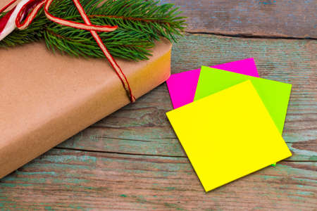 Christmas decoration. Boxes with Christmas gifts with sticky note. Beautiful packaging. Vintage gift box on wooden background. Handmade. Stock Photo