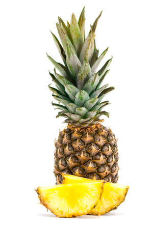 pineapple fruit with slices isolated on white background.