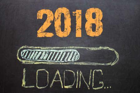 Loading New Year 2018 on  black background  Blackboard