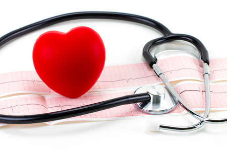 Cardiogram with stethoscope and red heart on white background, closeup.