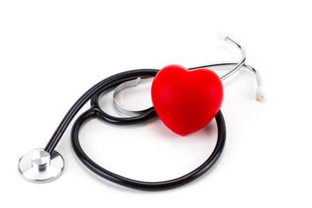 Red heart and a stethoscope isolated on white background. Banque d'images