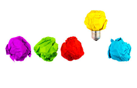 Great idea, standing out of the crowd concept. Crumpled paper as symbol of a light bulb, idea isolated on white background.