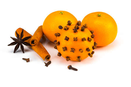 Ripe tangerines with cinnamon and cloves isolated on white. Stock Photo