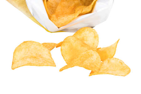 Potato chips poured out from packing on a white background.